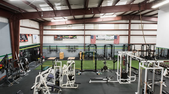 View of work out machines and equipment at Port City Sports Performance Gym in Wilmington